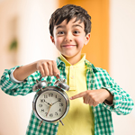 kid holding a clock