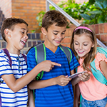 3 kids looking at the cell phone
